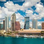 Tampa Florida skyline with sun and clouds